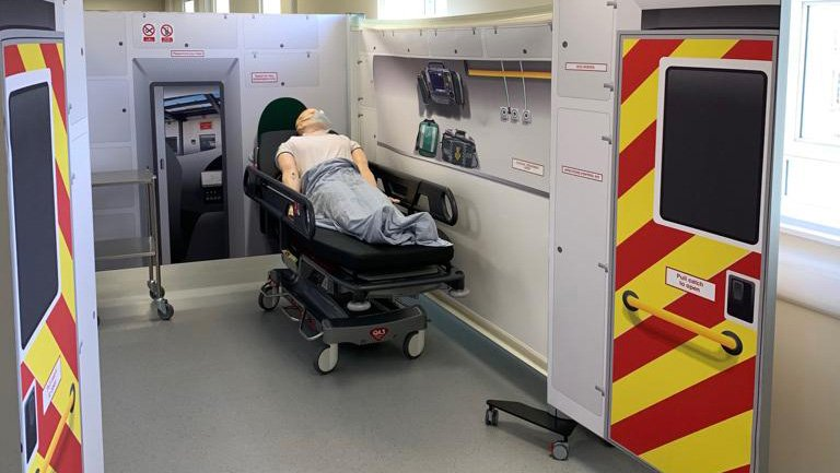 simulated patient on simulated ambulance