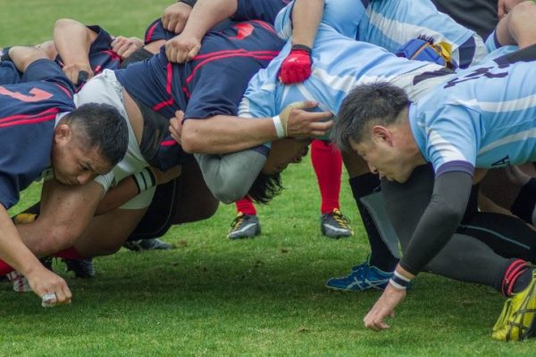 rugby players form a scrum